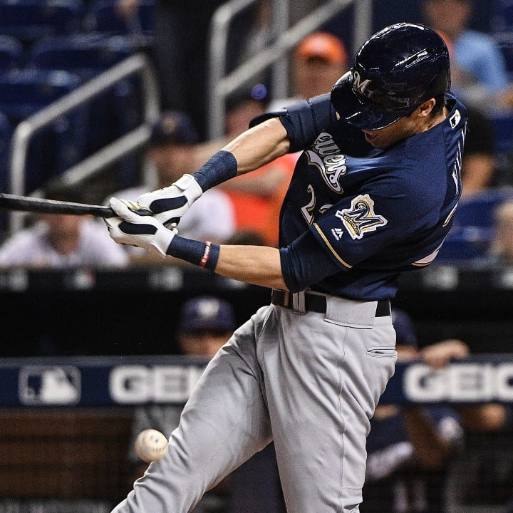 Christian Yelich of the Milwaukee Brewers hits the ball off his knee in the first inning