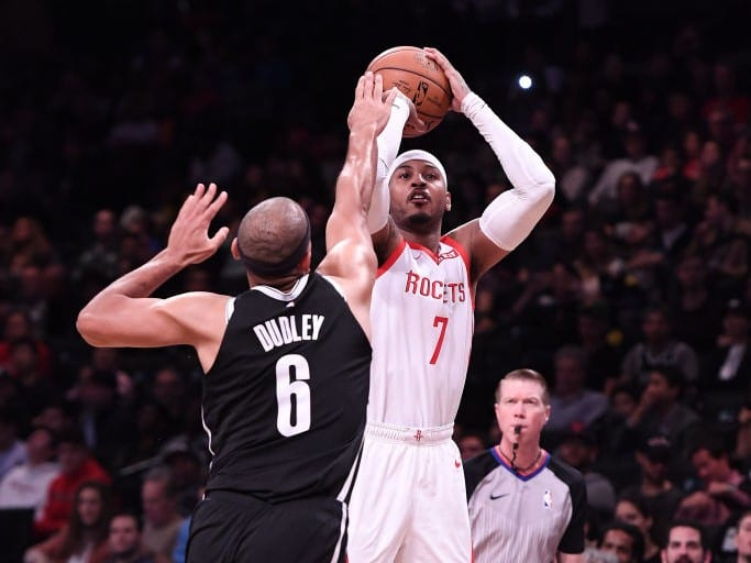 Carmelo Anthony #7 of the Houston Rockets shoots the ball against Jared Dudley #6