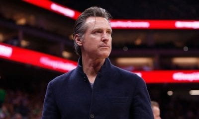 Governor of California Gavin Newsom looks on during a basketball game