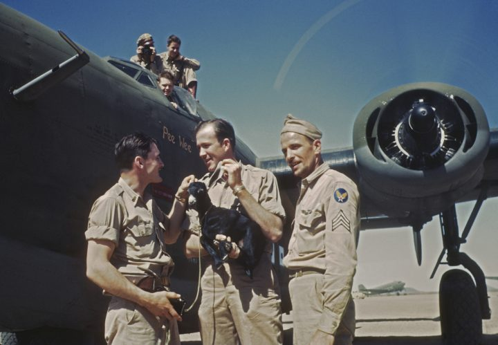 American airmen with a small goat at the US Army Air Corps. Air Transport Command base in Maiduguri, Nigeria June 1943. (Photo by Ivan Dmitri/Michael Ochs Archives/Getty Images)