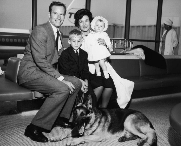 16th June 1962: American actor Charlton Heston and his wife, Lydia, sit with their son, Fraser, their daughter, Holly, and their German shepherd, Drago, New York International Airport (now JFK), New York City. (Photo by Hulton Archive/Getty Images)