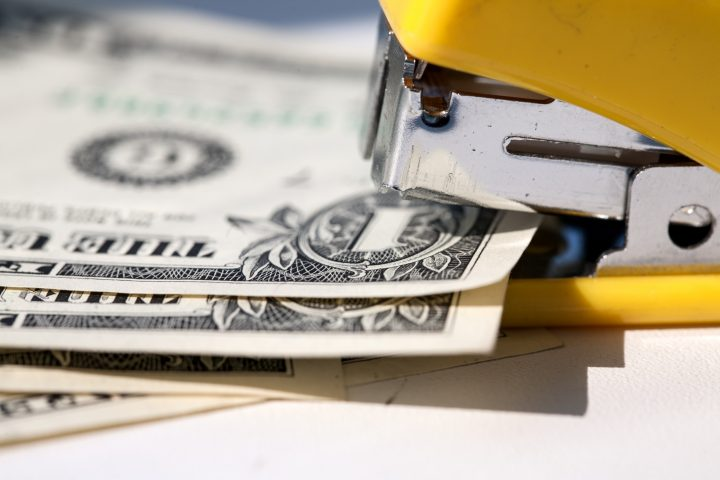 American dollars are held together by a stapler