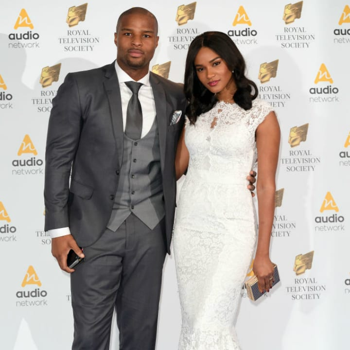 Osi Umenyiora and Leila Lopes