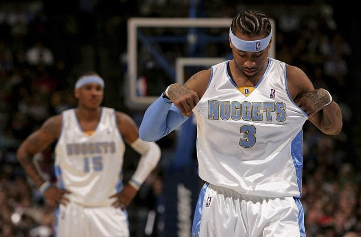 Allen Iverson #3 of the Denver Nuggets adjusts his jersey as Carmelo Anthony #15 awaits a free throw