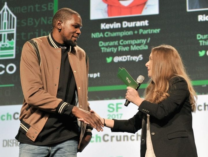 NBA Player and Durant Company/Thirty Five Media Partner Kevin Durant (L) and TechCrunch moderator Jordan Crook shake hands
