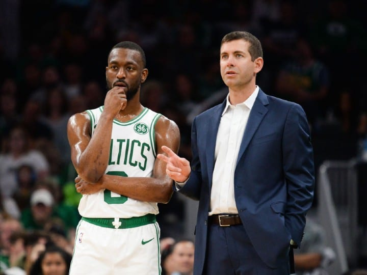 Kemba Walker #8 of the Boston Celtics talks with head coach Brad Stevens