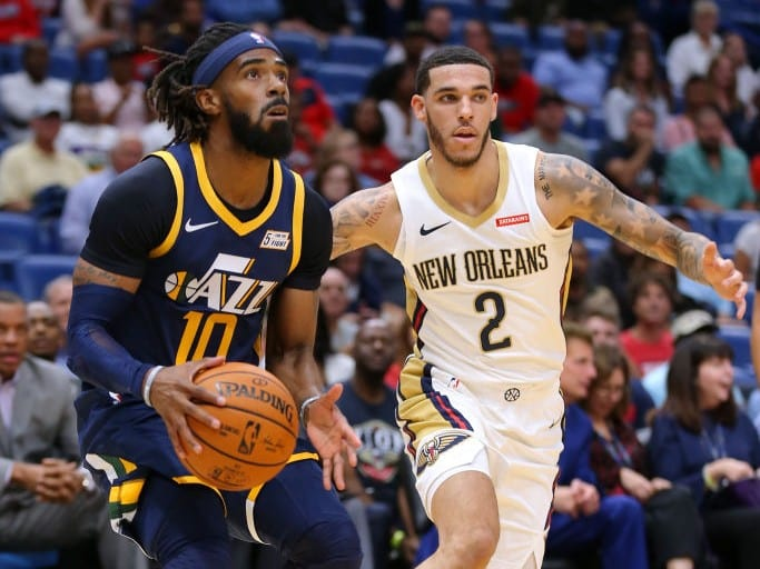 Mike Conley #10 of the Utah Jazz drives with the ball as Lonzo Ball #2 of the New Orleans Pelicans
