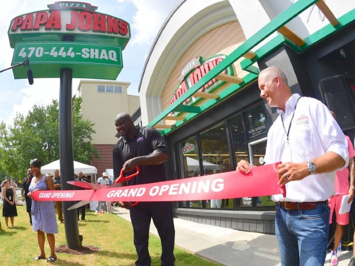 Keisha Lance Bottoms, Steve Ritchie and Shaquille O'Neal attend Shaq's Papa John's Pizza Grand Opening