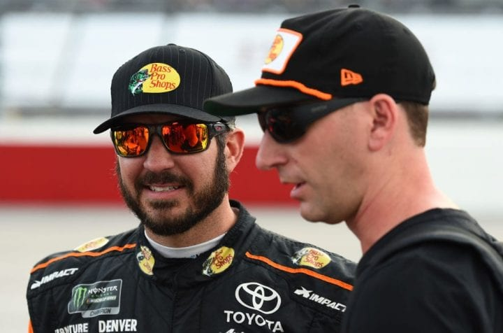 Martin Truex Jr., driver of the #78 Bass Pro Shops/5-hour ENERGY Toyota, and crew chief Cole Pearn talk on the grid