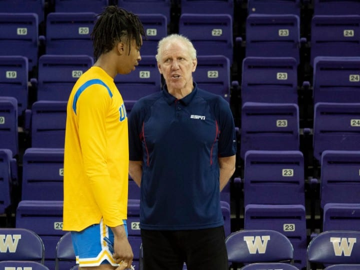 ESPN personality Bill Walton interacts with UCLA Bruins center Moses Brown (1) before a college basketball game