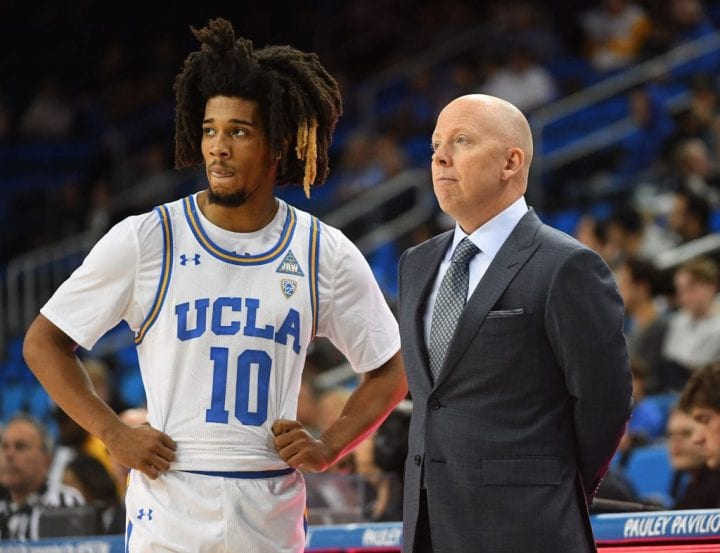 Tyger Campbell #10 talks with head coach Mick Cronin of the UCLA Bruins