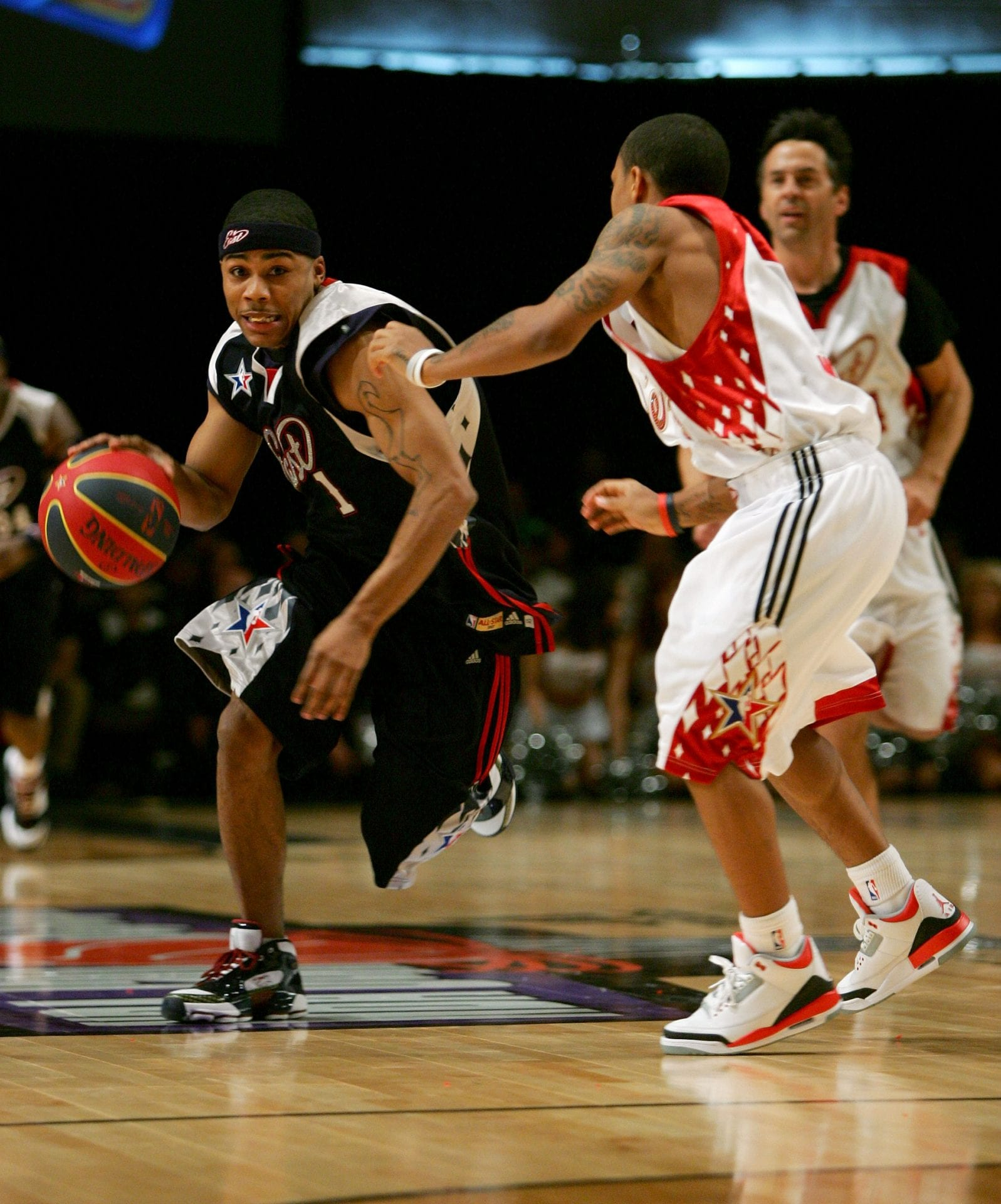 Rapper/east player Nelly drives to the basket against rapper/west player Bow Wow during the McDonald's NBA All-Star Celebrity Game