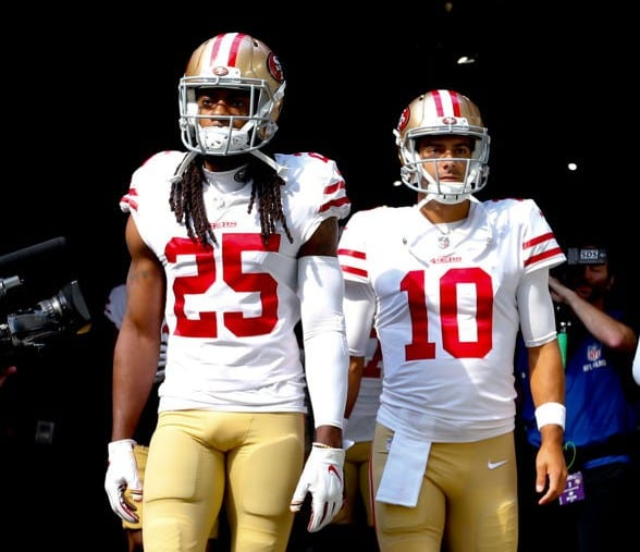 Richard Sherman #25 and Jimmy Garoppolo #10 of the San Francisco 49ers get ready to take the field