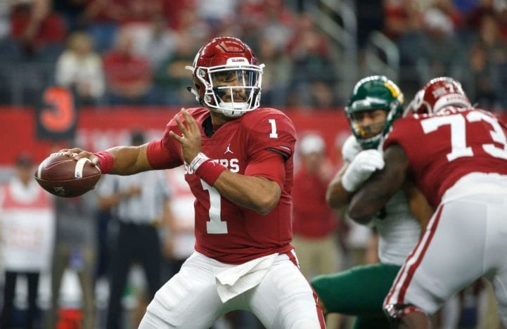 Jalen Hurts #1 of the Oklahoma Sooners looks to pass the ball