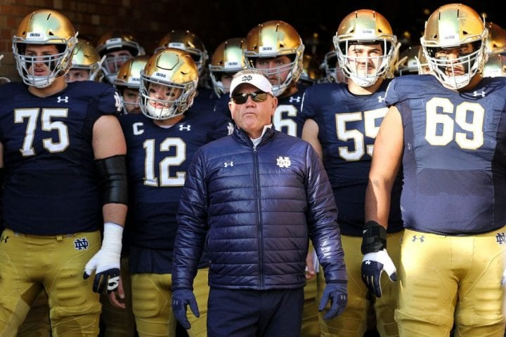 Head coach Brian Kelly of the Notre Dame Fighting Irish looks on before the game