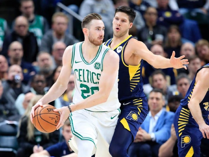 Gordon Hayward #20 of the Boston Celtics is defended by Doug McDermott #20 of the Indiana Pacers