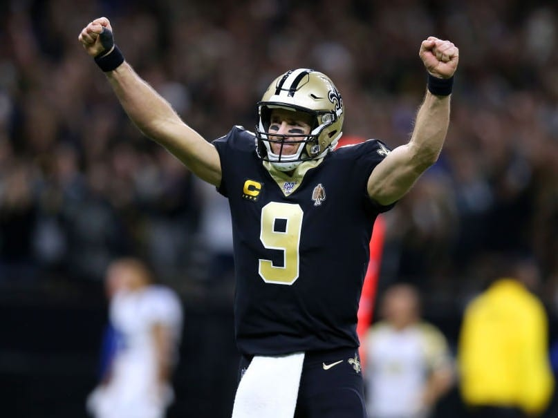 Quarterback Drew Brees #9 of the New Orleans Saints celebrates his 540th career touchdown pass,