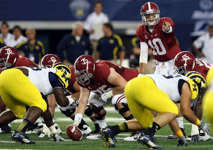 AJ McCarron #10 of the Alabama Crimson Tide during play against the Michigan Wolverines