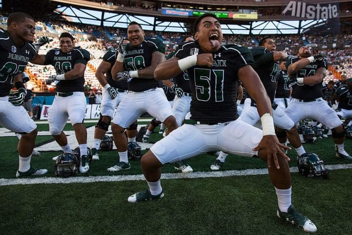 "Lance Williams #51 of the Hawaii Warriors and teammates perform ""haka"""