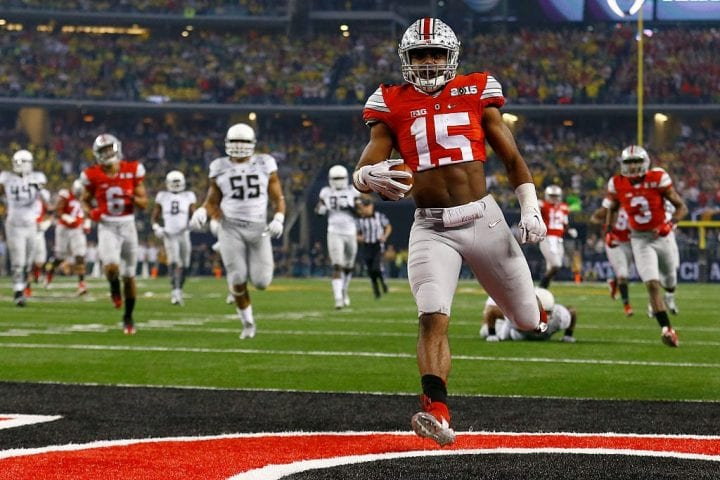 Running back Ezekiel Elliott #15 of the Ohio State Buckeyes scores a 33 yard touchdown