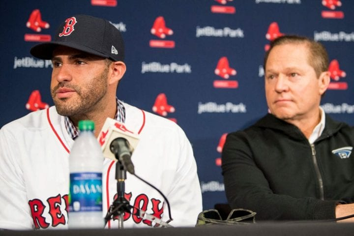 J.D. Martinez #28 of the Boston Red Sox reacts with agent Scott Boras as he speaks during a press conference