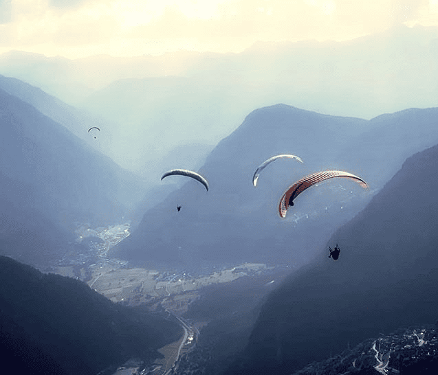 Bear Grylls paragliding over Everest