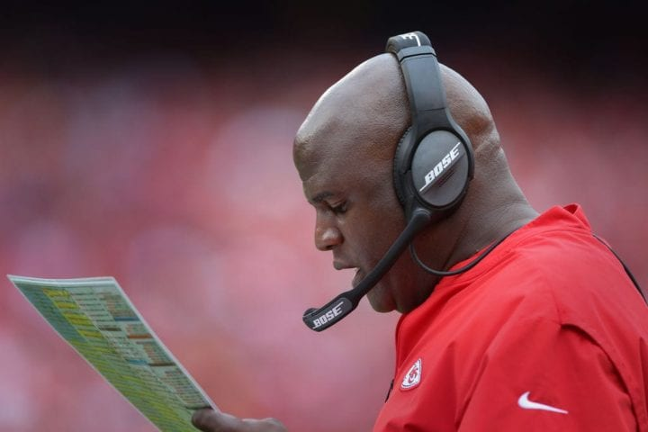 Kansas City Chiefs offensive coordinator Eric Bieniemy looks at his play sheet