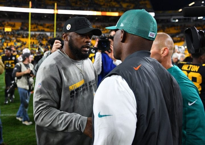 Head coach Mike Tomlin of the Pittsburgh Steelers is congratulated by head coach Brian Flores of the Miami Dolphins