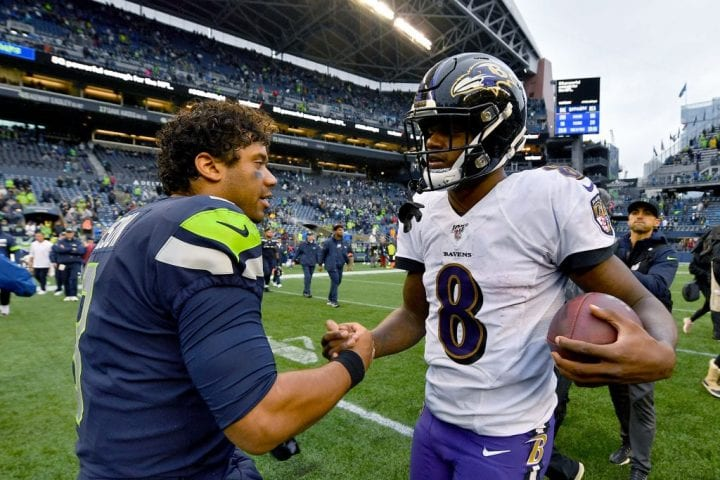 Russell Wilson #3 of the Seattle Seahawks and Lamar Jackson #8 of the Baltimore Ravens shake hands after the game