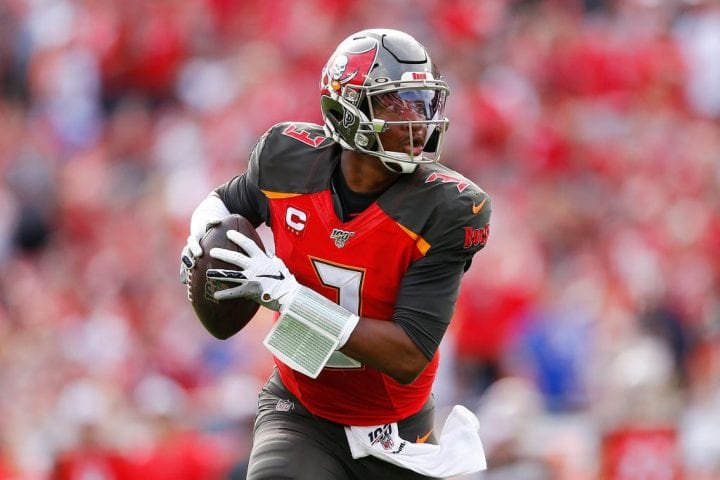 Jameis Winston #3 of the Tampa Bay Buccaneers runs into the endzone to convert a two-point conversion