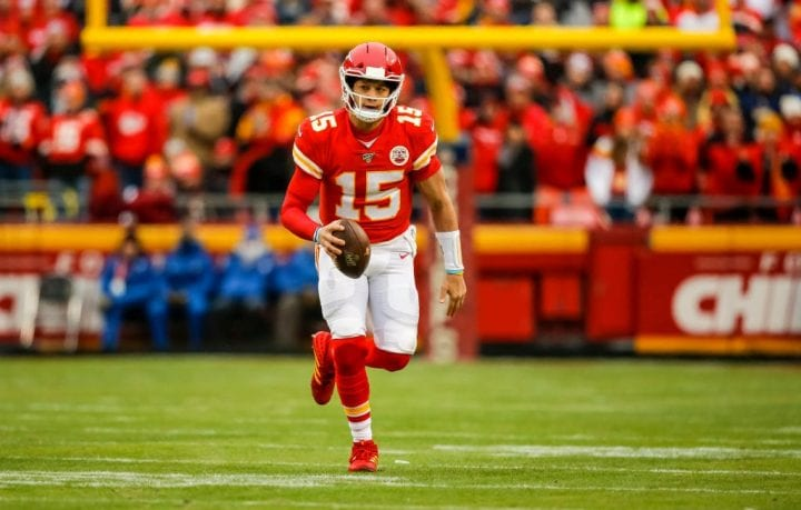 Patrick Mahomes #15 of the Kansas City Chiefs scrambles to the sidelines