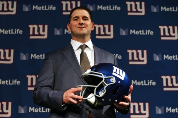 Joe Judge poses with a helmet after he was introduced as the new head coach of the New York Giants
