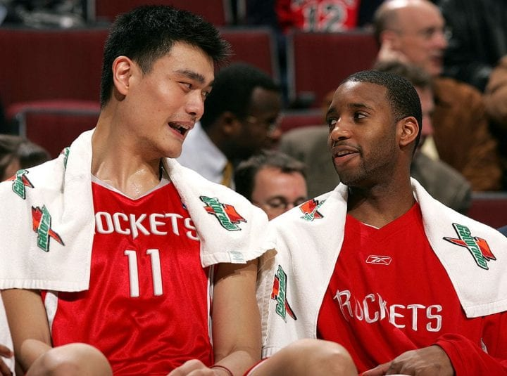 Yao Ming #11 and Tracy McGrady #1 of the Houston Rockets talk during a game