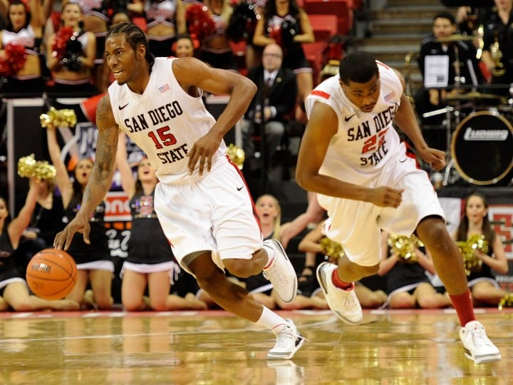 Kawhi Leonard #15 and Chase Tapley #22 of the San Diego State Aztecs start a fast break