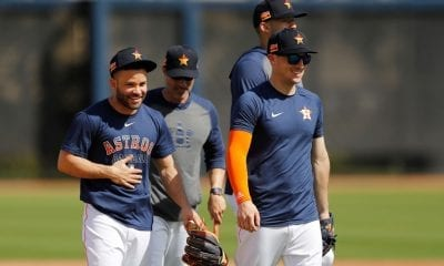 Jose Altuve #27 of the Houston Astros laughs with Alex Bregman #2 during a team workout