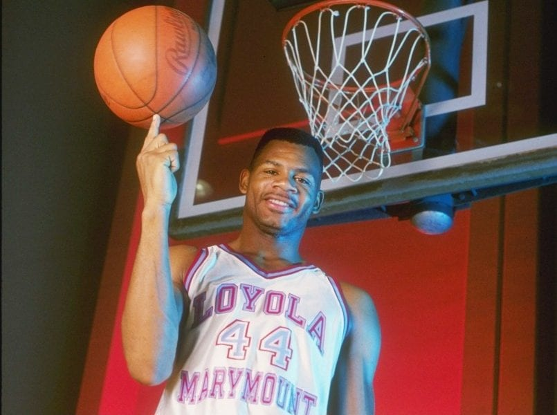 Forward Hank Gathers of the Loyola-Marymount Lions spins a basketball on his finger.