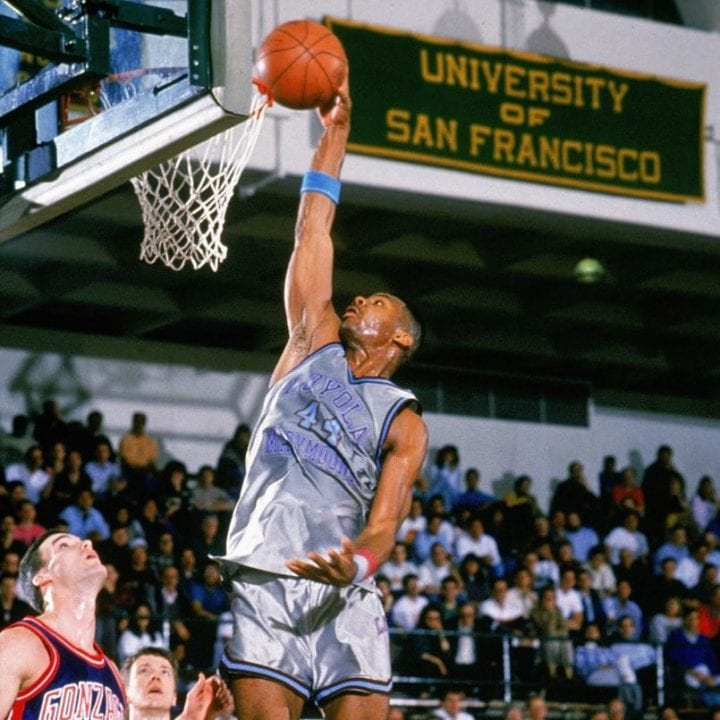 Hank Gathers #44 of the Loyola Marymount Lions drives to the basket against West Coast Conference rivals Gonzaga